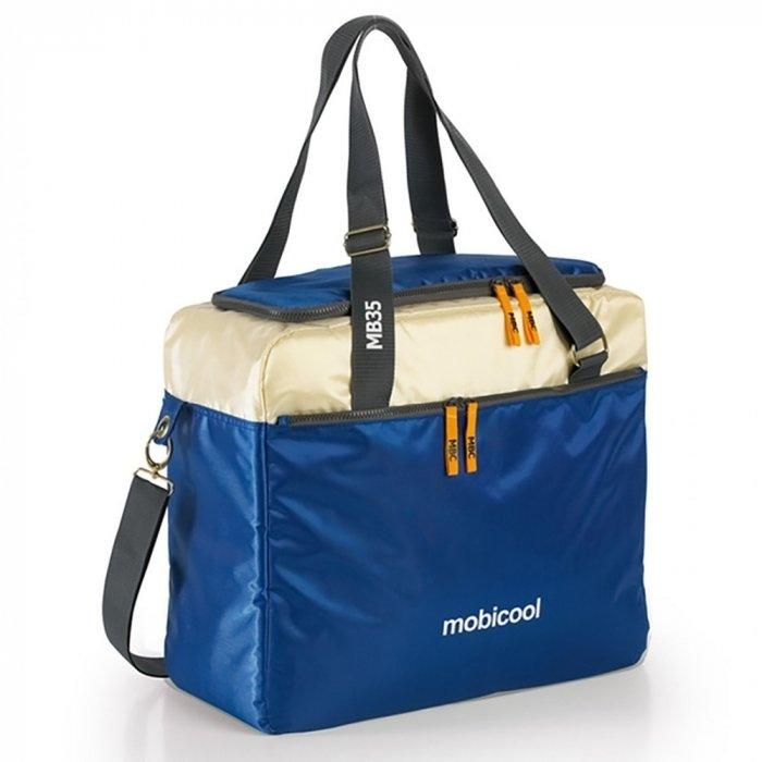 Сумка-холодильник Mobicool sail 35Сумки-холодильники<br>Если вы любите пикники, то изотермический контейнер Mobicool (Мобикул) sail 35 от известной торговой марки станет прекрасным приобретением. Это изделие представляет собой удобную тридцатипятилитровую сумку, оснащенную не только термокамерой, но также внешними карманами, плечевым ремнем и ручками. Подобный контейнер может сохранять не только холод, но и тепло, поэтому их использование будет актуально в любое время года.<br>Особенности и преимущества представленной модели сумки-холодильника от компании Mobicool:<br><br>Сделано в виде удобной сумки.<br>Прочный материал изготовления.<br>Внутреннее термоотталкивающее покрытие.<br>Большая вместительность.<br>Сохранения и холода, и тепла.<br>Удобно переносить и хранить.<br>Компактные размеры, небольшой вес.<br>Высокая степень износоустойчивости.<br><br>Сумки-холодильники представляют собой удобные и компактные изотермические контейнеры, которые работают по принципу термоса. Такая сумка может сохранять не только холод, но и тепло. Здесь в широком ассортименте представлены сумки-холодильники от торговой марки Mobicool - известного немецкого бренда, продукция которого популярна как на иностранном, так и на российском рынке. Компания-производитель использует для своих контейнеров исключительно качественные материалы, что обуславливает их высокую износоустойчивость.<br><br>Страна: Германия<br>Объем, л: 35<br>Мощность, Вт: None<br>Питание, В: Нет<br>Темп. max, С: None<br>Темп. min, С: None<br>Габариты ВxШxД, мм: 390x440x170<br>Вес, кг: 1<br>Гарантия: 1 год<br>Кабель питания: Нет<br>Назначение: Сумкахолодильник