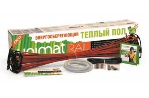 Теплый пол Unimat RAIL-2500Нагревательные маты<br>Наш онлайн-магазин представляет посетителям теплый пол стержневого типа RAIL-2500 &amp;ndash; еще одну разработку отечественной торговой марки UNIMAT. Данная отопительная система выполнена из греющих стержней, соединенных параллельно, и обладает эффектом саморегуляции мощности. Не перегревается, не изнашивается и будет продолжать полноценно функционировать, даже если один из кабелей выйдет из строя.<br>Особенности и преимущества теплых полов серии RAIL от бренда UNIMAT:<br><br>Энергосбережение и экономия денег при эксплуатации: экономичнее кабельных аналогов до 60%.<br>Благодаря эффекту саморегуляции UNIMAT RAIL не боится запирания мебелью и последующего перегрева, а это означает, что вам не нужно задумываться на многие годы вперед о расстановке мебели в утепляемом помещении.<br>В работа UNIMAT RAIL используется не только самый экологичный способ для обогрева помещений, но и самый полезный, так как инфракрасные волны дают живое, полностью безопасное для человека и животных тепло.<br>Конструкция мата позволяет укладывать его непосредственно в плиточный клей или тонкую стяжку, что весьма удобно, когда нет нужды заливать толстую стяжку или необходимо соблюдать уровень пола в помещении.<br>Благодаря параллельному соединению греющих стержней мат не выйдет из строя и продолжит работу, даже при возможном повреждении одного стержня.<br>Монтаж пола отличается легкостью и быстротой, не требуя при этом от особых профессиональных навыков и квалификаций.<br><br>Российская торговая марка UNIMAT разработала линейку теплых полов под названием RAIL. Это семейство &amp;ndash; новое слово в отопительных системах такого типа. UNIMAT RAIL использует инфракрасное излучение для прогрева помещения, что дает сразу несколько преимуществ. Во-первых, ИК-обогрев намного экономичнее и позволяет сократить расходу на электроэнергию до 60%! Во-вторых, инфракрасное излучение обеспечивает равномерный эффективный прогрев всего объема помещения. И в-тре