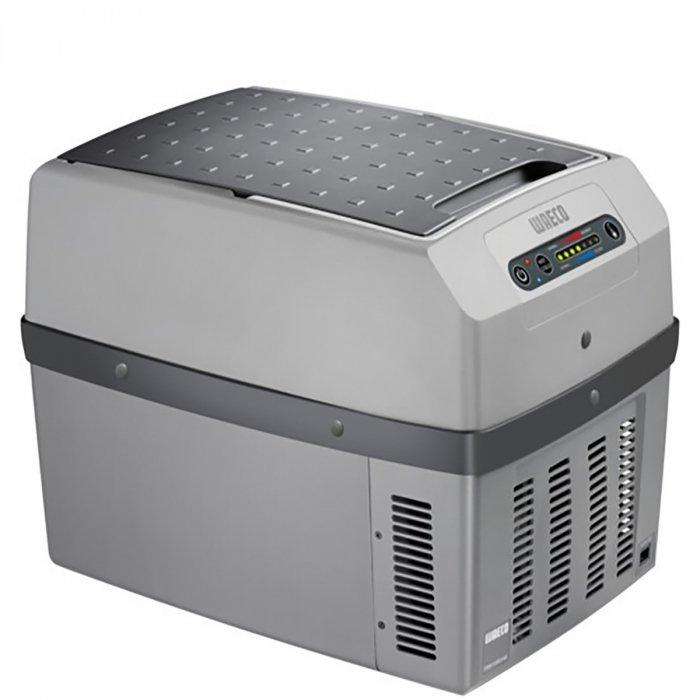 Термоэлектрический автохолодильник Waeco-Dometic TropiCool TCX-2121-30 литров<br>Современный компактный автомобильный холодильник Waeco (Ваеко) TropiCool TCX-21 &amp;ndash; отличный спутник в длительных автомобильных поездках. С его помощью вы обеспечите себе нормальный полноценный рацион и прохладные напитки. Представленный агрегат прост в использовании и совершенно неприхотлив в эксплуатационных условиях.<br>Особенности и преимущества термоэлектрического автомобильного холодильника Waeco представленной модели:<br><br>Питание: 12/24 В DC, 230 В AC<br>Энергопотребление:&amp;nbsp; 12 В &amp;ndash; 46 Вт, 24 В &amp;ndash; 50 Вт, 230 В &amp;ndash; 64 Вт<br>Диапазон температур: охлаждение на 25&amp;deg;C ниже температуры окружающей среды, нагрев до +65&amp;deg;C<br>Система &amp;mdash; термоэлектрика (элемент Пельтье)<br>Отсутствие фреона<br>Простота использования<br>Эргономичная конструкция<br>Охлаждение и подогрев<br>Большой ресурс работы<br>Качественные комплектующие<br>Плотная термоизоляция<br>Незатруднительная транспортировка<br>Оптимальная вместительность<br><br>Термоэлектрические холодильники Waeco не используют для работы фреон, а значит не оказывают негативного воздействия на окружающую среду, поскольку их принцип работы совершенно не похож на принцип работы привычных ботовых холодильных приборов. Также стоит отметить, что агрегаты отличаются большим ресурсом работы и неприхотливы в эксплуатационных условиях. Обратите внимание: термоэлектрические холодильники способны не только охлаждать, но и подогревать, поэтому станут отличным спутником в длительных поездках.<br>&amp;nbsp;<br><br>Страна: Германия<br>Объем, л: 21<br>Мощность, Вт: 64<br>Питание, В: 12/24/220<br>Max температура, C: 65<br>Min температура, C: None<br>Функция подогрева: None<br>Дельта t, C: 25<br>Кабель питания: Есть<br>Назначение: Автохолодильник<br>ГабаритыВШД,мм: 450x420x303<br>Вес, кг: 6<br>Гарантия: 2 года