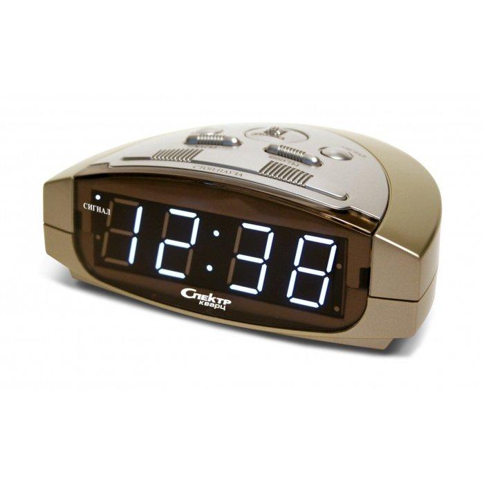 Часы без проекции Спектр СК 0915 Ш(С)-БЧасы без проекции<br>Спектр СК 0915 Ш(С)-Б   это модель электронных настольных часов, оснащенных надежным будильником, который позволит вам проснуться утром и не пропустить важную встречу или мероприятие. Модель показывает время с помощью цифровой индикации, подсвеченной белым цветом, в 24-х часовом форме. Часы работают как от электричества, так и от батареек, если есть сбои в сети электропитания.<br>Основные достоинства рассматриваемой модели настольных часов от компании Спектр:<br><br>Кварцевый механизм высокой точности.<br>Будильник.<br>Автоматическое повторение сигнала будильника (snooze). Если включена функция повтора сигнала будильника, то будильник снова сработает примерно через 8 - 9 минут после отключения. Можно отключить эту функцию.<br>Регулировка яркости индикации. С помощью переключателя можно отрегулировать яркость отображения времени. Положение + - более яркое, положение - - стандартная яркость свечения.<br>Формат времени 24 ч.<br>Питание от сети.<br>Цвет корпуса под дерево с серебристыми вставками.<br>Цвет индикации - зеленый.<br><br>Настольные часы от торговой марки Спектр   это огромная линейка всевозможных современных моделей с различным дизайнерским решением и функционалом, которые могут заинтересовать самую разную аудиторию. Модели от данного производителя отличаются высоким качеством сборки, компактными размерными характеристиками, простой и современностью.<br><br>Страна: Россия<br>Питание, В: Сеть/Бат.<br>Тип батарейки: КРОНА<br>Колво батареек: 1<br>Адаптер к 220В: Есть<br>С будильником: Да<br>Радиодатчик: Нет<br>С метеостанцией: Нет<br>В помещении t, С: Нет<br>За окном t, С: Нет<br>Влажность в помещении: Нет<br>Влажность за окном: Нет<br>Давление: Нет<br>Прогноз погоды: Нет<br>Габариты, мм: 135x90x50<br>Вес, кг: 1<br>Гарантия: 1 год<br>Ширина мм: 90<br>Высота мм: 135<br>Глубина мм: 50