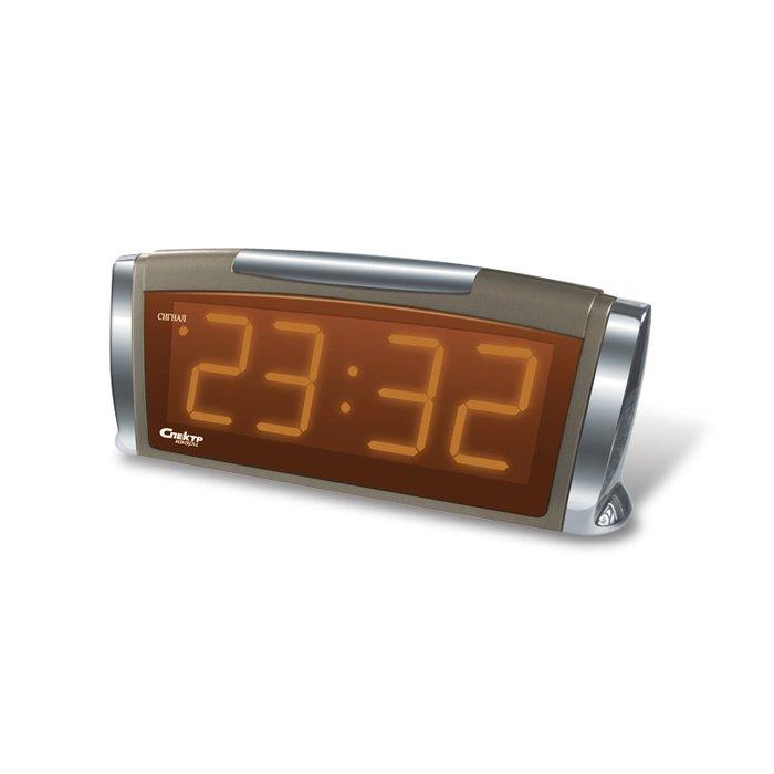 Часы без проекции Спектр СК 1811 Т(Х)-ОЧасы без проекции<br>Компактные и визуально привлекательные настольные часы с функцией будильника Спектр СК 1811 Т(Х)-О   это отличный вариант для домашнего использования. Данные часы требуют подключения к сети электропитания и имеют цифровую индикацию времени желтого цвета. Звук будильника повторяется автоматически через определенный промежуток времени благодаря специальной функции.<br>Основные достоинства рассматриваемой модели настольных часов от компании Спектр:<br><br>Кварцевый механизм высокой точности.<br>Будильник.<br>Автоматическое повторение сигнала будильника (snooze). Если включена функция повтора сигнала будильника, то будильник снова сработает примерно через 8 - 9 минут после отключения. Можно отключить эту функцию.<br>Возможность регулировки яркости дисплея.<br>Формат времени 24 ч.<br>Питание от сети.<br><br>Настольные часы от торговой марки Спектр   это огромная линейка всевозможных современных моделей с различным дизайнерским решением и функционалом, которые могут заинтересовать самую разную аудиторию. Модели от данного производителя отличаются высоким качеством сборки, компактными размерными характеристиками, простой и современностью. <br><br>Страна: Россия<br>Питание, В: Сеть/Бат.<br>Тип батарейки: КРОНА<br>Колво батареек: 1<br>Адаптер к 220В: Есть<br>С будильником: Да<br>Радиодатчик: Нет<br>С метеостанцией: Нет<br>В помещении t, С: Нет<br>За окном t, С: Нет<br>Влажность в помещении: Нет<br>Влажность за окном: Нет<br>Давление: Нет<br>Прогноз погоды: Нет<br>Габариты, мм: 225x65x95<br>Вес, кг: 1<br>Гарантия: 1 год<br>Ширина мм: 65<br>Высота мм: 225<br>Глубина мм: 95